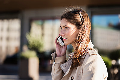 Young woman on the phone - p312m1192775 by Karl Forsberg
