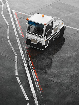 Truck at airport from above - p1280m2215717 by Dave Wall