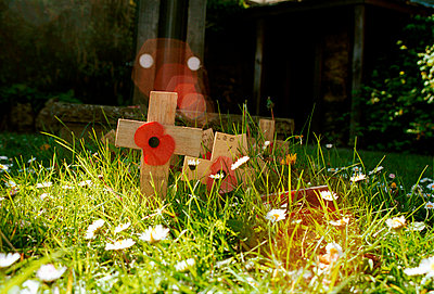 War memorial with red poppies - p3881874 by Astrid Schulz