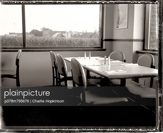 Cafe table by window - p378m795676 by Charlie Hopkinson