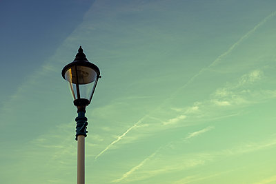 Lamppost against an evening sky - p1228m1168859 by Benjamin Harte