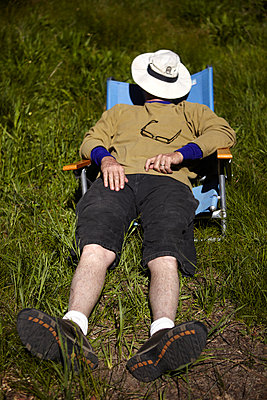 Man Napping Outdoors - p1260m1077998 by Ted Catanzaro