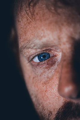 Portrait of man with blue eyes - p1628m2212013 by Lorraine Fitch