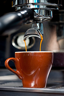 A double shot of espresso being poured from an espresso maker - p301m799805f by Halfdark