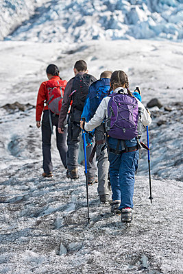 Family walking on glacier - p429m726995f by Henn Photography