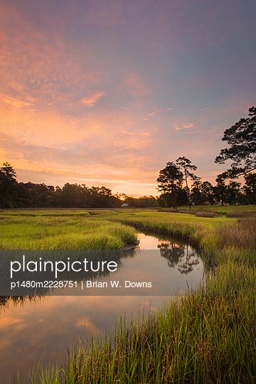Sunrise over marshland, North Carolina - p1480m2228751 by Brian W. Downs