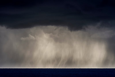 Rain falls over the ocean; Cannon Beach, Oregon, United States of America - p442m1449166 by Robert L. Potts