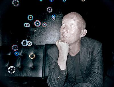 Bald men marvels at soap bubbles - p1207m1109494 by Michael Heissner