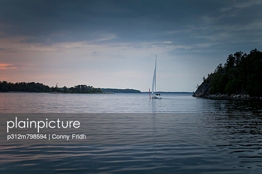 Sailing boat at stormy weather