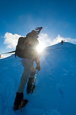Walkers climbing the snowy slopes of Sgorr Dhearg near Glen Coe; Highlands, Scotland - p442m999935 by Ian Cumming