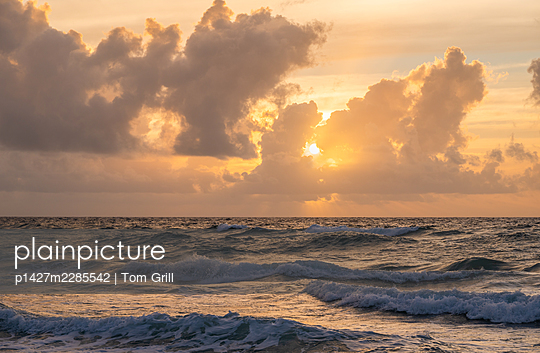 Sunset over sea - p1427m2285542 by Tom Grill