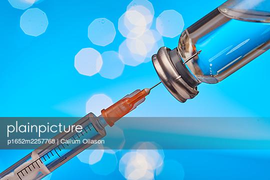 Syringe and vaccine, COVID-19 - p1652m2257768 by Callum Ollason