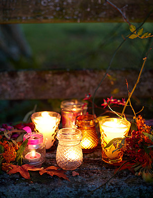Lit tealights on step in Autumn - p349m2167847 by Sussie Bell