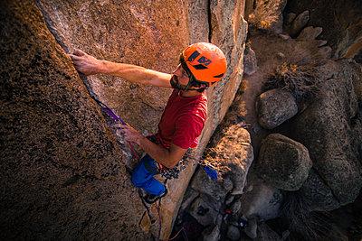 Climber trad climbing, Little Egypt, Bishop, California, USA - p924m2074318 by Alex Eggermont