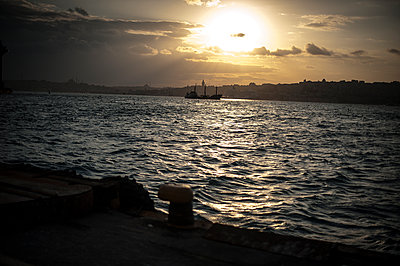 Boat on Bosphorus sea at sunset - p1007m1134830 by Tilby Vattard