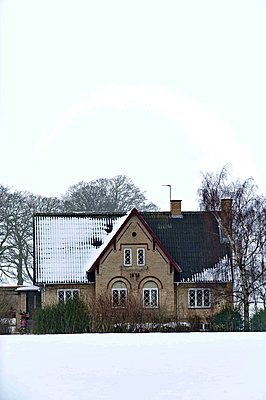 Country house set in winter landscape - p349m790891 by Polly Eltes