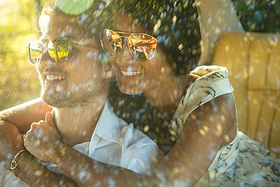Woman Embracing Man inside Car - p669m1443115 by Jutta Klee