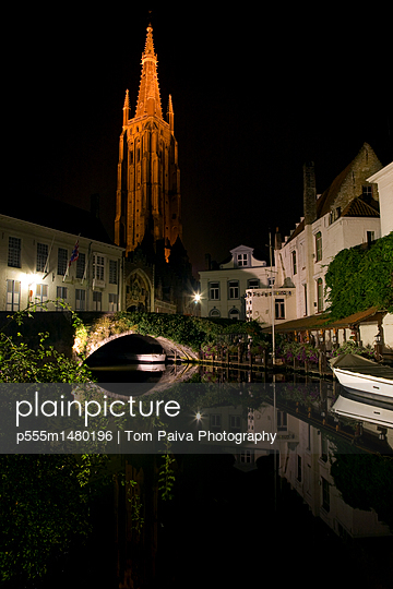 Church and buildings along canal at night - p555m1480196 by Tom Paiva Photography