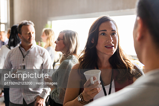 Business people talking, networking during conference coffee break - p1192m2123200 by Hero Images