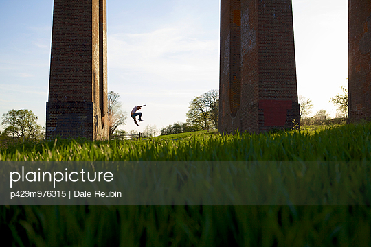 Parkour athlete experimenting with movement at Balcombe Viaducts, Sussex, United Kingdom