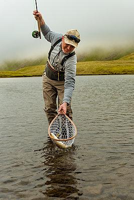 Man fishing in lake - p312m2051441 by Hans Berggren