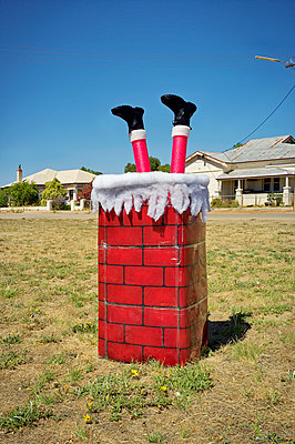 Chimney with Santa legs - p1125m2013979 by jonlove