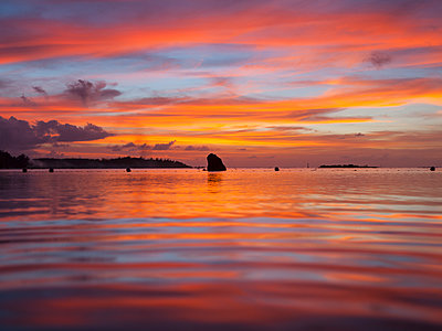 Sunset at the seaside, Raiatea, Tahiti - p1542m2142270 by Roger Grasas