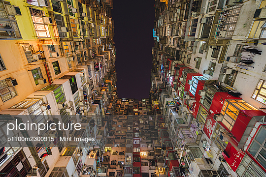 Low angle view of balconies and windows of Monster Building in Quarry Bay. - p1100m2300915 by Mint Images
