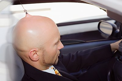 Car driver with antenna implant on head - p1093m2223239 by Sven Hagolani