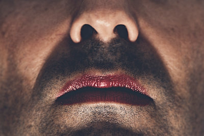 Man with a painted red lips - p1423m2019952 by JUAN MOYANO