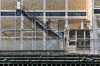 Fire escape exterior stair case - p1048m1497690 by Mark Wagner