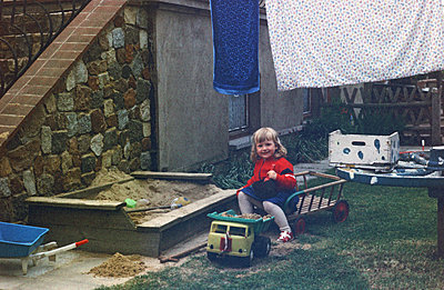 Germany, Girl plays in the sandpit in the GDR - p986m2223983 by Friedrich Kayser