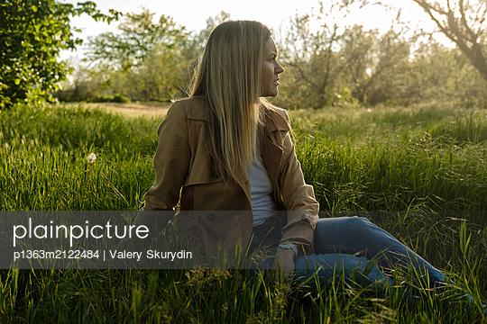 Woman on grass - p1363m2122484 by Valery Skurydin