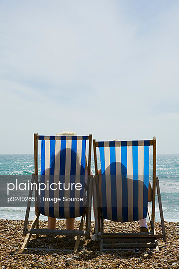 People in deckchairs - p9249285f by Image Source