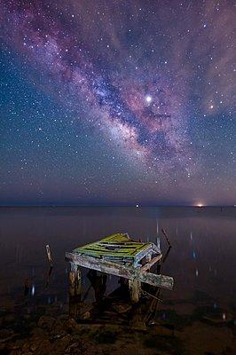 Milky Way over the sea in Delta de Ebro Natural Park - p1166m2104697 by Cavan Images