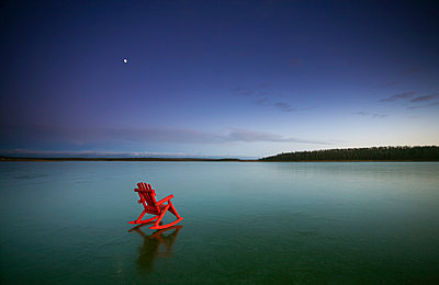 A small red rocking horse, on a frozen lake.  - p1100m993399f by Mint Images