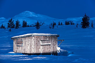 Wooden building in winter mountains - p312m2118668 by Johner