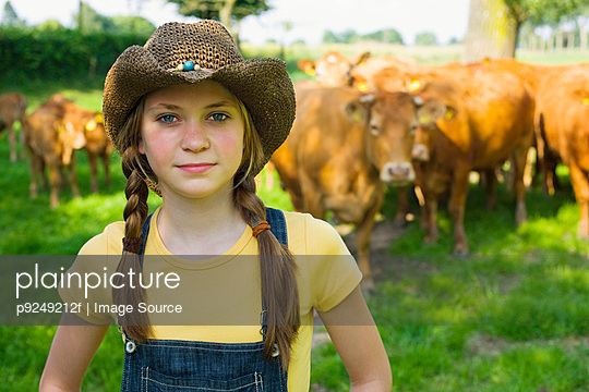 Portrait of a girl on a farm - p9249212f by Image Source