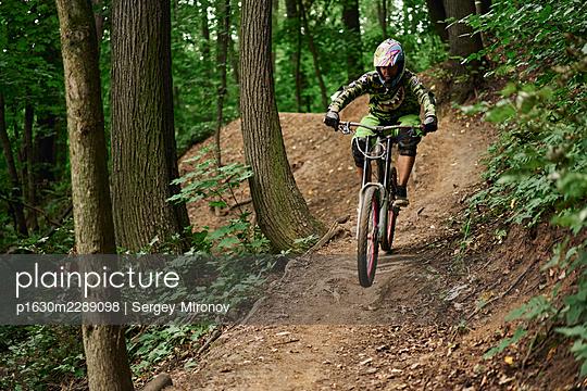 Mountainbiker at full speed - p1630m2289098 by Sergey Mironov