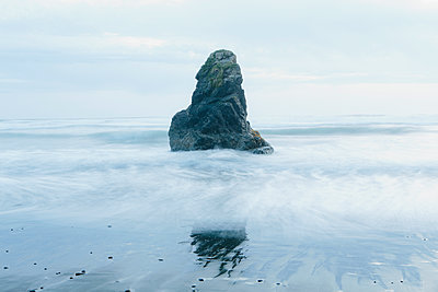 Rock formation on the coastline, exposed on the beach at low tide.  - p1100m1158497 by Mint Images