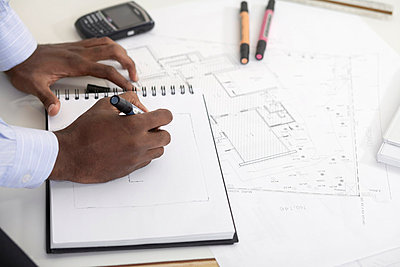 Man drawing on notepad (focus on hands) - p5142615f by Clover photography
