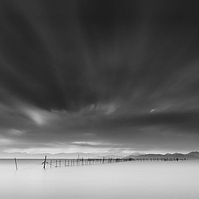 Long exposure shot of wooden sticks in the water, Lake Biwa, Shiga Prefecture, Japan - p1166m2201376 by Cavan Images