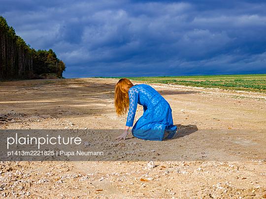 Woman in blue dress - p1413m2221825 by Pupa Neumann