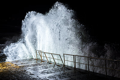 Night time waves lit with strobe lighting - p1201m1463388 by Paul Abbitt