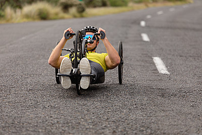 Man cycling on recumbent bicycle - p1315m2131527 by Wavebreak