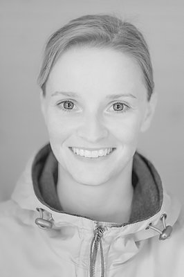 Young woman, smiling - p552m2109635 by Leander Hopf