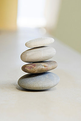 Stack of pebbles - p9246845f by Image Source
