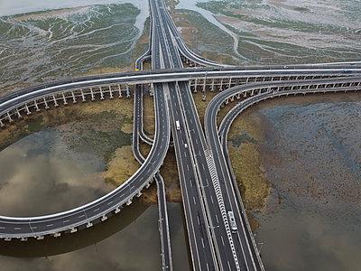 Aerial view of bridge in the sea - p1166m2111852 by Cavan Images