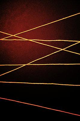 Woolen threads against a dark background - p1248m2260659 by miguel sobreira