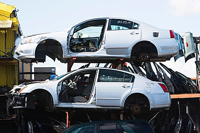 Cars stacked in scrap yard - p924m805801f by Ditto